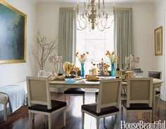 When entertaining in their Jackson, MS, house, Nancy and John Price often set out a buffet — which they favor over sit-down meals — on the Louis Philippe-style dining table. The wonderfully unusual candelabra was handmade in Brazil. See the rest of Nancy Price's home.   - HouseBeautiful.com
