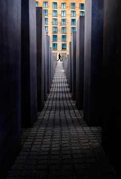 The pillars create lines that draw attention to the person at the far end of the photo.