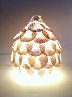Beautiful table lamp decorated with old book pages. Made by Shelli Worley of North Carolina, found on Etsy.