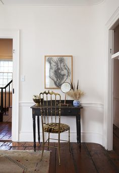 An antique writing desk gets its quirk from a gilded chair upholstered in Clarence House Leopard silk velvet.  Click to see more from interior designer Michelle Smith.