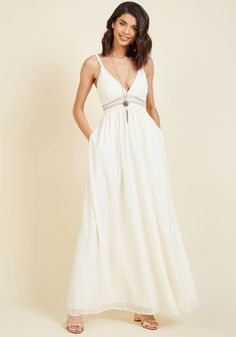 <p>In this ivory maxi dress, you make sophistication look sweet and polish look lighthearted. Part of our ModCloth namesake label, this gown is glammed up with a beaded neckline to coordinate with its copper-embroidered waist, a smocked back, and a tie to top it off. Though not as fancy as some, this dress is classy as ever!</p>