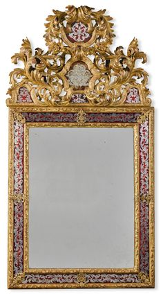 A Louis XIV style verre églomisé and carved giltwood mirror