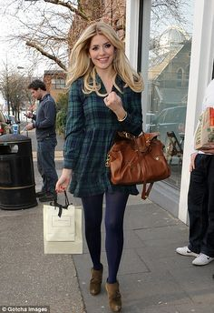 Holly's tartan dress and navy tights