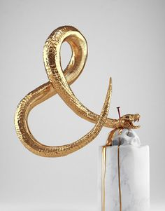 Hedi Xandt - Gold Sculpture #sculpture #slither #tail #macabre #serpent #snake #ampersand #kill #gold #nail
