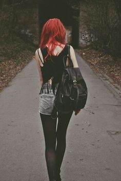 Red hair and black outfit