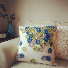 two crochet cushions