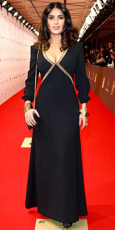 SALMA HAYEK    Salma goes with a black-and-gold theme, from her criss-crossed caftan to her bold bangles, at the Bambi awards in Düsseldorf, Germany.