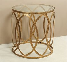 Interlude Prima Grand Table. Interlocking almond shapes and an antique gold finish give the Prima Grand Table a sultry, sophisticated vibe. – Modish Store