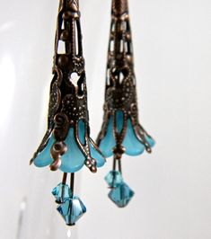 Teal Fairy Earrings Antique Copper Filigree Bead Cap & Lucite Flower with Turquoise and Indicolite Swarovski Crystals Beaded Jewelry Turquoise Jewelry, Boho Jewelry, Jewelry Crafts, Beaded Jewelry, Jewelery, Light Turquoise, Silver Jewelry, Lucite Flower Earrings, Bead Earrings