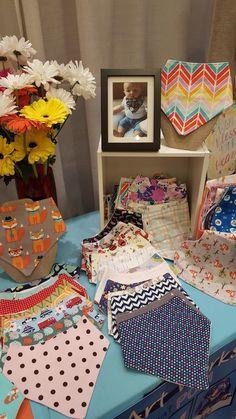 handmade bandana bibs on display in craft fair booth