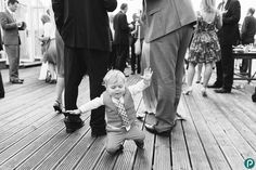 A quirky and fun reportage wedding photos. This toddler caught in the moment. Wedding photography by Dorset based wedding photojournalist across the UK and international.