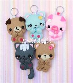 adorable keychains of various animals, NO tutorial, but easy enough to figure out, and I love the kitty and the bears...they all have something cute about them...in felt