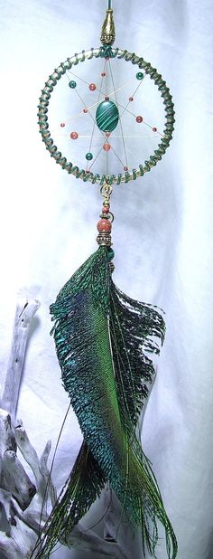 Check out this item in my Etsy shop https://www.etsy.com/uk/listing/261835962/small-peacock-dream-catcher-seven