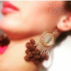 A personal favorite from my Etsy shop https://www.etsy.com/listing/465513272/pompom-earrings-beaded-tassel-earrings