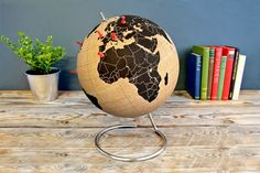 Pinable corkboard globe - we totally want this.  Thanks to Doubletakesblog for the link:http://www.suck.uk.com/products/cork-globe/#info