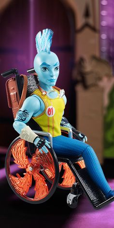 """Finnegan Wake Monster High Doll, 2015 - Finnegan is the son of a merman. He is 17. As a merman, he doesn't have legs and uses a wheelchair to get around school. His favorite activity is working out in the school pool. His pet peeve is monsters who think that because he's in a chair, he'll let anything hold him back. His freaky flaw is that he's a scaredevil who doesn't like to be told, """"That's too dangerous."""" Though, sometimes he may dive in headfirst too quickly."""