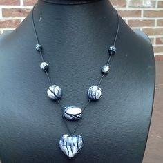 #Halsketting (48 cm ) met Zwart-wit-grijze #kralen op  koord €7,00…