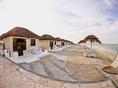 The Royal Island Beach Club, World Islands, Dubai Outdoor Gazebos, Outdoor Decor, Timber Cabin, Timber Structure, Luxury Cabin, Pool Bar, Thatched Roof, Island Beach, Cabana