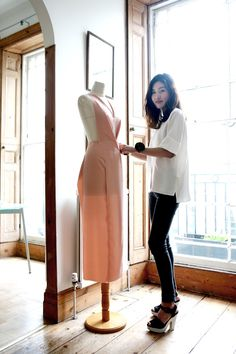 "Designer Rejina Pyo draping a dress design on a dressform [***Pinner Claire Sew-Incidentally http://www.pinterest.com/clairesews/ says:""I love the pleat/dart details from bust to waist on this design!!""***] This photo recently appeared in the INSTYLE July 2014 UK Magazine (pg 121)"