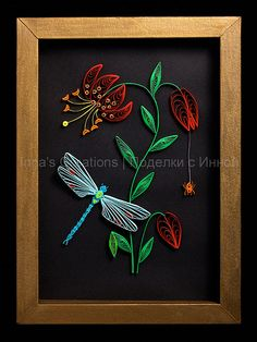 lovely example of quilling ... black background accentuates the colors ... dragonfly .. leaves ... flowers ...