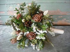 Fresh evergreens and pine cone bridal bouquet -- gorgeous! I like that it's primarily filler greens with little touches of white. Would like to add gold spray painted babies breath to any bouquet.