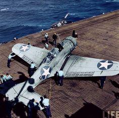 SBD Dauntless dive-bomber on US aircraft carrier deck, World War II.