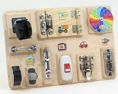Travel busy board Sensory activity wood toy Baby busy board toddler Fine motor board Special needs Board with locks Fidget board Wood Gift Diy Sensory Board, Sensory Wall, Sensory Toys, Diy Busy Board, Busy Board Baby, Toddler Busy Board, Educational Baby Toys, Learning Toys, Activities For Girls