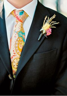 Love this groom's fun tie. The boutonniere is made of wheat, grasses, and flowers.