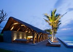 Architect Vo Trong Nghia has added new bamboo buildings to the Naman Retreat, a luxury resort and spa on Vietnam's spectacular coastline near Da Nang. The new buildings, housing a restaurant with soaring bamboo pillars and a beach bar that looks out onto crystal blue water, are additions to the existing hotel and spa facility. The bamboo beams and thatched roofs of the new buildings allow guests to feel as though they have been swept away to an exotic yet luxurious island.