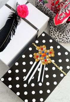 Ditch the wrapping paper and head over to your local thrift shop for some awesome gift-wrapping finds. For a few bucks you can pick up some ribbon, pretty boxes and even sparkly pins to wrap up your gifts and save you some cash. #holiday #holidays #giftwrapping #thriftshop #creative