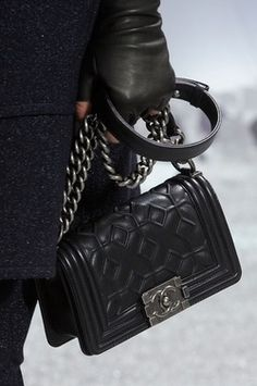 Chanel - look at the geometric pattern on this boy bag.     If only I didn't have to make house payments...   #Chanel #handbags