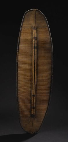 African: , Mongo Region (Democratic Republic of Congo). Shield. Basketry,wood. Height: 51 ¾ inches Width: 15 ½ inches Depth: 1 inch... Image #1