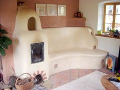 A couple more ideas for cob designed heat and stoves...this one would warm the bench too!