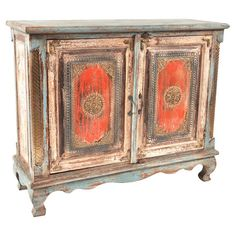 Handcrafted distressed wood cabinet with Moroccan-style embellished doors. Product: CabinetConstruction Material: ...