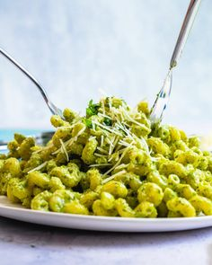 Pesto cavatappi is a fast and easy dinner recipe that's full of big flavor! The pesto cream sauce comes together in minutes. | healthy dinner recipes | vegetarian meals | pasta dishes easy | pesto recipes | pesto pasta | #pesto #cavatappi #pestopasta #pestocavatappi #pastarecipe #easypasta #pasta #quickpasta