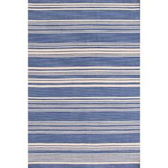 This Cottage Stripe French Blue Wool Woven  Rug would look fabulous right beside a white puffy blanket layered bed.
