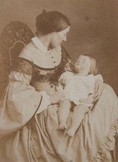 Woman cradling her deceased infant. ca.1860. post-mortem photography, very popular in the victorian age