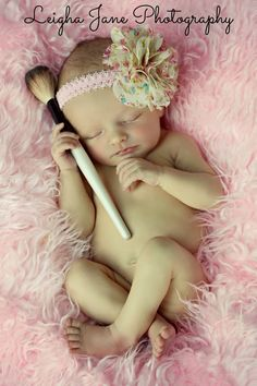 Newborn photography... little girl with makeup and brushes etc