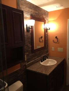 Photos of bathroom remodels that we have done. Vanities and vanity tops. Kitchen And Bath Design Center, Masculine Bathroom, Granite Vanity Tops, Cherry Cabinets, Toilet Design, Plank Flooring, Bathrooms, Shower, Mirror