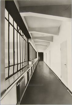 Hallway inside the Bauhaus Building in Dessau, 1925-1926. Unidentified photographer. / Charnel House