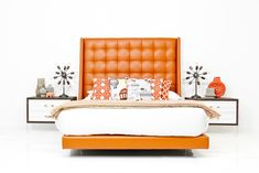 """Find your best slumber yet on this St. Tropez Bed in Hermes Orange Faux Leather. The prominent base and 72"""" high headboard contribute to the modern look this bed so easily achieves. 72"""" Tall Headboard"""
