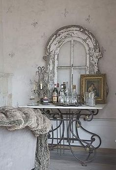 Love window...would be cool with an antique mirror in it.