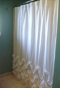 This is gorgeous and the ruffles would help weigh the curtain down so it doesn't get sucked in against you when showering.  DIY Waves of Ruffles Shower Curtain.