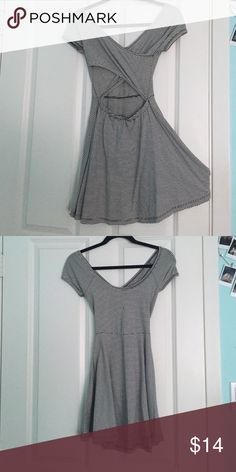 Black and white striped Brandy Melville dress Black and white striped Brandy Melville dress with open crossed back. Super cute and comfy! It has a little hole in the chest area, but is still totally wearable Brandy Melville Dresses Mini
