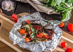 20-Minute Tomato-Basil Grilled Fish Foil Packets | http://thescrumptiouspumpkin.com/2014/07/22/20-minute-tomato-basil-grilled-fish-foil-packets/