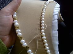 making a French hood in silk taffeta - attaching the billiment of freshwater pearls