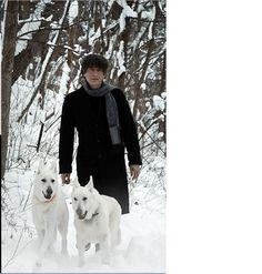Writer Neil Gaiman with his white shepherds Cabal & Lola