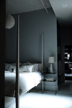soft grey bedroom and behind partly walls is the dressing room and bathroom