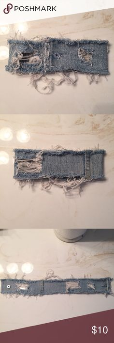 Distressed Denim Choker Original design. This is handmade by me. Made from old Levi's jeans. 100% Cotton. About 16 inches long. You can cut the white strings if you want a less distressed look. Let me know what y'all think! Jewelry Necklaces