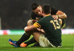All Blacks player Sonny Bill Williams Official comforts centre Jesse Kriel of the Springboks at the Rugby World Cup semi final.